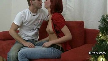 and on tied gagged sofa Woman dominates foot